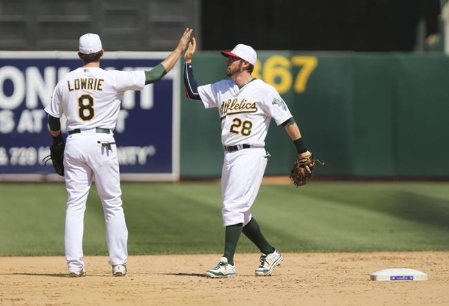 Jul 4, 2013; Oakland, CA, USA; Oakland Athletics shortstop Jed Lowrie (8) high fives second baseman Eric Sogard (28) after the win against the Chicago Cubs at O.co Coliseum. The Oakland Athletics defeated the Chicago Cubs 1-0. Mandatory Credit: Kelley L Cox-USA TODAY Sports