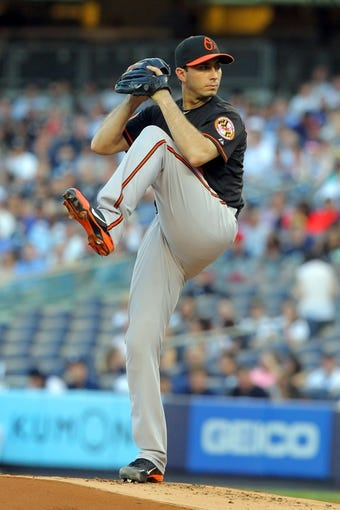 Jul 5, 2013; Bronx, NY, USA; Baltimore Orioles starting pitcher Miguel Gonzalez (50) pitches against the New York Yankees during the first inning of a game at Yankee Stadium. Mandatory Credit: Brad Penner-USA TODAY Sports