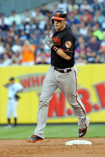 Jul 5, 2013; Bronx, NY, USA; Baltimore Orioles catcher Matt Wieters (32) rounds the bases after hitting a two-run home run against the New York Yankees during the second inning of a game at Yankee Stadium. Mandatory Credit: Brad Penner-USA TODAY Sports