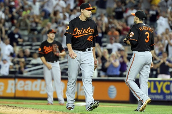 Jul 5, 2013; Bronx, NY, USA; Baltimore Orioles relief pitcher Jim Johnson (43) reacts after committing a fielding error against the New York Yankees during the ninth inning of a game at Yankee Stadium. Mandatory Credit: Brad Penner-USA TODAY Sports