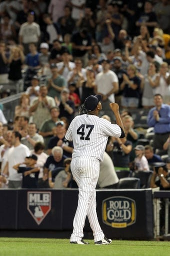 Jul 5, 2013; Bronx, NY, USA; New York Yankees starting pitcher Ivan Nova (47) reacts after pitching the ninth inning against the Baltimore Orioles during a game at Yankee Stadium. Mandatory Credit: Brad Penner-USA TODAY Sports