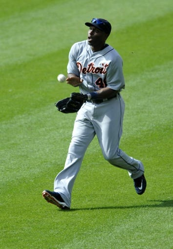 Jul 6, 2013; Cleveland, OH, USA; Detroit Tigers right fielder Torii Hunter (48) catches a fly ball by Cleveland Indians shortstop Asdrubal Cabrera (not pictured) in the third inningat Progressive Field. Mandatory Credit: David Richard-USA TODAY Sports