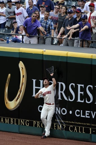 Jul 6, 2013; Cleveland, OH, USA; Cleveland Indians right fielder Ryan Raburn (9) makes a catch on a deep fly ball by Detroit Tigers shortstop Jhonny Peralta (not pictured) in the seventh inning at Progressive Field. Mandatory Credit: David Richard-USA TODAY Sports