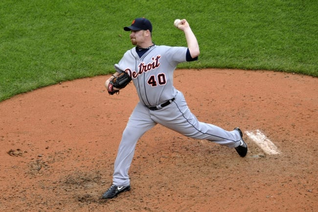 Jul 6, 2013; Cleveland, OH, USA; Detroit Tigers relief pitcher Phil Coke (40) delivers in the sixth inning against the Cleveland Indians at Progressive Field. Mandatory Credit: David Richard-USA TODAY Sports