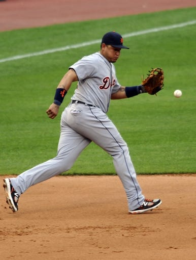 Jul 6, 2013; Cleveland, OH, USA; Detroit Tigers third baseman Miguel Cabrera (24) misses a ground ball for an error in the seventh inning against the Cleveland Indians at Progressive Field. Mandatory Credit: David Richard-USA TODAY Sports