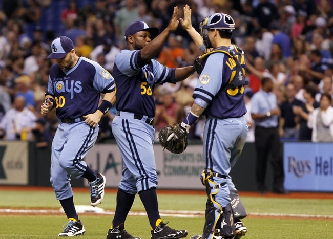Jul 6, 2013; St. Petersburg, FL, USA; Tampa Bay Rays relief pitcher Fernando Rodney (56) and catcher Jose Lobaton (59) congratulate each other after they beat the Chicago White Sox at Tropicana Field. Tampa Bay Rays defeated the Chicago White Sox 3-0. Mandatory Credit: Kim Klement-USA TODAY Sports