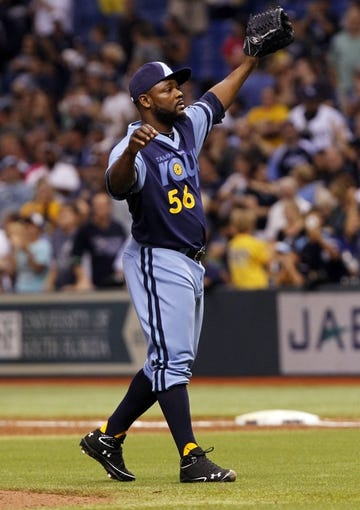 Jul 6, 2013; St. Petersburg, FL, USA; Tampa Bay Rays relief pitcher Fernando Rodney (56) reacts after he got the last out of the game against the Chicago White Sox at Tropicana Field. Tampa Bay Rays defeated the Chicago White Sox 3-0. Mandatory Credit: Kim Klement-USA TODAY Sports