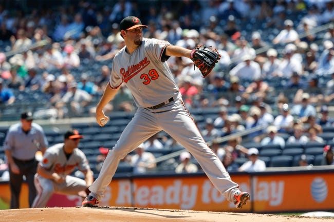 Jul 7, 2013; Bronx, NY, USA;  Baltimore Orioles starting pitcher Jason Hammel (39) pitches during the first inning against the New York Yankees at Yankee Stadium. Mandatory Credit: Anthony Gruppuso-USA TODAY Sports