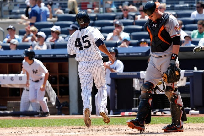 Jul 7, 2013; Bronx, NY, USA;   New York Yankees left fielder Zoilo Almonte (45) crosses the plate to score during the second inning against the Baltimore Orioles at Yankee Stadium. Mandatory Credit: Anthony Gruppuso-USA TODAY Sports