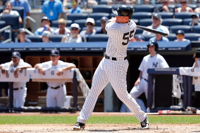 Jul 7, 2013; Bronx, NY, USA;  New York Yankees first baseman Lyle Overbay (55) singles to right center during the second inning against the Baltimore Orioles at Yankee Stadium. Mandatory Credit: Anthony Gruppuso-USA TODAY Sports