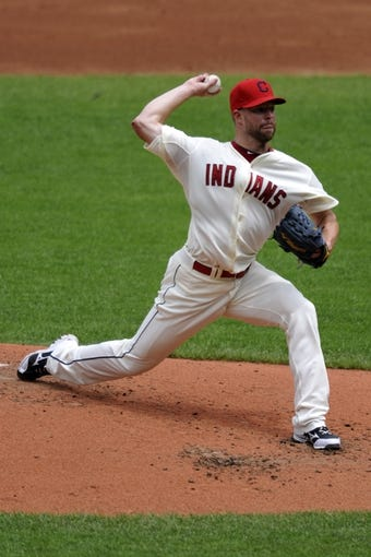 Jul 7, 2013; Cleveland, OH, USA; Cleveland Indians starting pitcher Corey Kluber (28) delivers in the second inning against the Detroit Tigers at Progressive Field. Mandatory Credit: David Richard-USA TODAY Sports