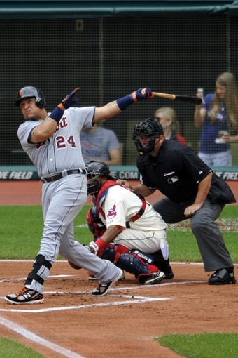 Jul 7, 2013; Cleveland, OH, USA; Detroit Tigers third baseman Miguel Cabrera (24) hits a solo home run in the first inning against the Cleveland Indians at Progressive Field. Mandatory Credit: David Richard-USA TODAY Sports