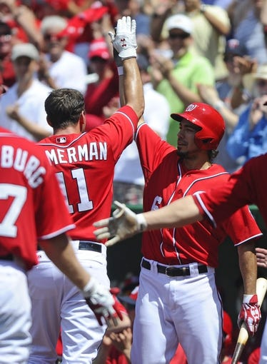 Jul 7, 2013; Washington, DC, USA; Washington Nationals third baseman Ryan Zimmerman (11) is congratulated by Anthony Rendon (6) after hitting a grand slam during the third inning against the San Diego Padres at Nationals Park. Mandatory Credit: Brad Mills-USA TODAY Sports