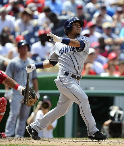 Jul 7, 2013; Washington, DC, USA; San Diego Padres second baseman Alexi Amarista (5) watches his two run homer during the fourth inning against the Washington Nationals at Nationals Park.  Mandatory Credit: Brad Mills-USA TODAY Sports