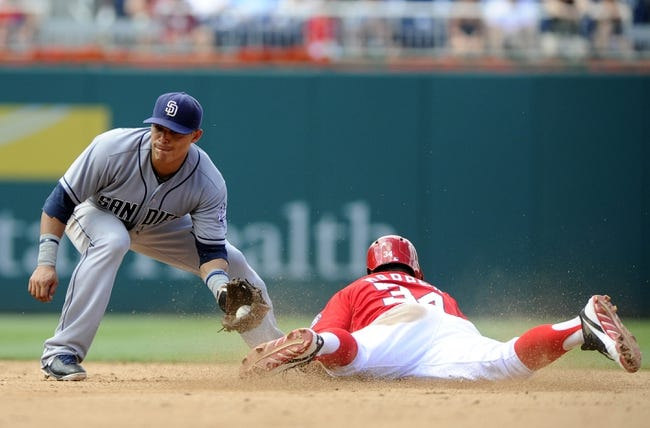 Jul 7, 2013; Washington, DC, USA; Washington Nationals left fielder Bryce Harper (34) steals second base as San Diego Padres second baseman Alexi Amarista (5) is unable to apply the tag during the fifth inning at Nationals Park. Mandatory Credit: Brad Mills-USA TODAY Sports