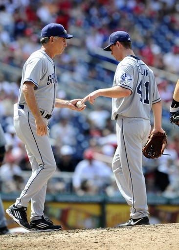 Jul 7, 2013; Washington, DC, USA; San Diego Padres starting pitcher Robbie Erlin (41) hands the ball to manger Bud Black (left) after being removed from the game during the fifth inning against the Washington Nationals at Nationals Park.  Mandatory Credit: Brad Mills-USA TODAY Sports
