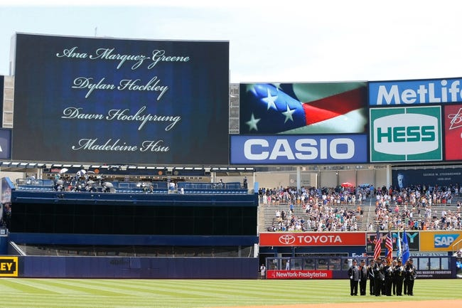 Jul 7, 2013; Bronx, NY, USA;  Newtown, CT first responders joint color guard on the field as the names of the victims are displayed on the screen before the game between the New York Yankees and the Baltimore Orioles at Yankee Stadium. Mandatory Credit: Anthony Gruppuso-USA TODAY Sports