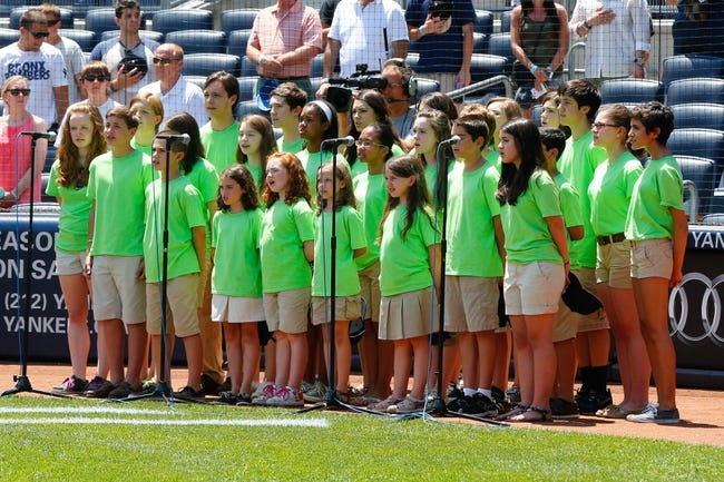 Jul 7, 2013; Bronx, NY, USA;  Newtown youth choir sings the National Anthem before the game between the New York Yankees and the Baltimore Orioles at Yankee Stadium. Mandatory Credit: Anthony Gruppuso-USA TODAY Sports
