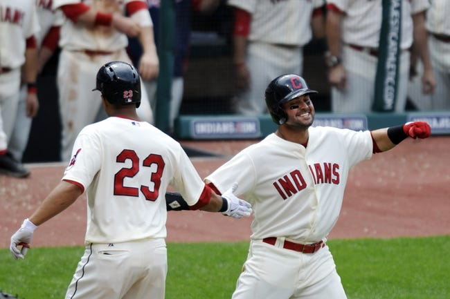 Jul 7, 2013; Cleveland, OH, USA; Cleveland Indians left fielder Michael Brantley (23) celebrates his two-run home run with first baseman Nick Swisher (33) in the eighth inning against the Detroit Tigers at Progressive Field. Mandatory Credit: David Richard-USA TODAY Sports