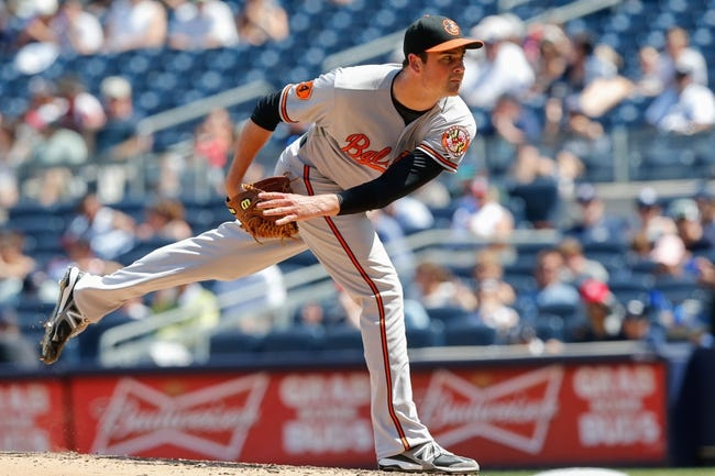 Jul 7, 2013; Bronx, NY, USA;   Baltimore Orioles relief pitcher T.J. McFarland (66) delivers a pitch during the sixth inning against the New York Yankees at Yankee Stadium. Baltimore Orioles won 2-1.  Mandatory Credit: Anthony Gruppuso-USA TODAY Sports