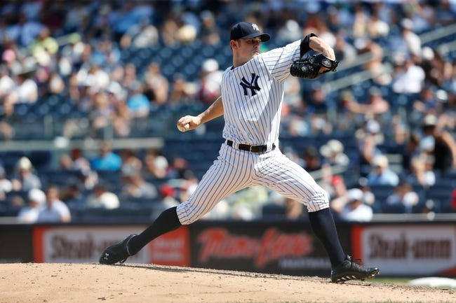 Jul 7, 2013; Bronx, NY, USA;   New York Yankees relief pitcher David Robertson (30) pitches during the eighth inning against the Baltimore Orioles at Yankee Stadium. Baltimore Orioles won 2-1.  Mandatory Credit: Anthony Gruppuso-USA TODAY Sports