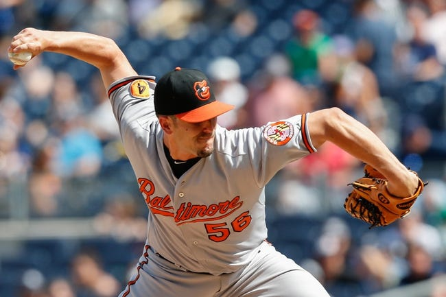 Jul 7, 2013; Bronx, NY, USA;  Baltimore Orioles relief pitcher Darren O'Day (56) pitches during the eighth inning against the New York Yankees at Yankee Stadium. Baltimore Orioles won 2-1.  Mandatory Credit: Anthony Gruppuso-USA TODAY Sports