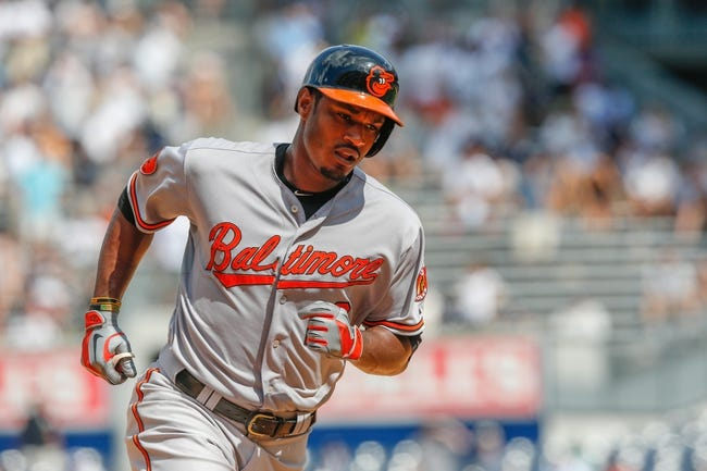 Jul 7, 2013; Bronx, NY, USA;  Baltimore Orioles center fielder Adam Jones (10) rounds the bases on his two run home run during the ninth inning against the New York Yankees at Yankee Stadium. Baltimore Orioles won 2-1.  Mandatory Credit: Anthony Gruppuso-USA TODAY Sports
