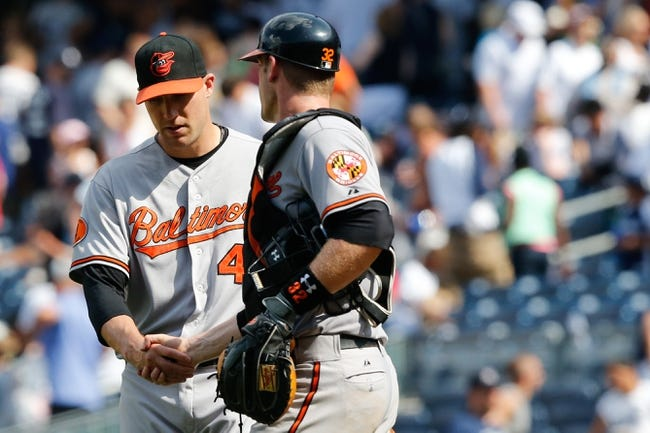 Jul 7, 2013; Bronx, NY, USA;  Baltimore Orioles relief pitcher Jim Johnson (43) and catcher Matt Wieters (32) celebrate the win against the New York Yankees at Yankee Stadium. Baltimore Orioles won 2-1.  Mandatory Credit: Anthony Gruppuso-USA TODAY Sports