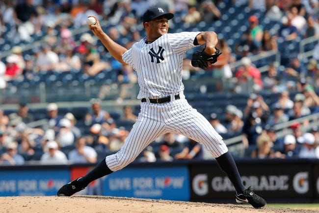 Jul 7, 2013; Bronx, NY, USA;   New York Yankees relief pitcher Mariano Rivera (42) pitches during the ninth inning against the Baltimore Orioles at Yankee Stadium. Baltimore Orioles won 2-1.  Mandatory Credit: Anthony Gruppuso-USA TODAY Sports