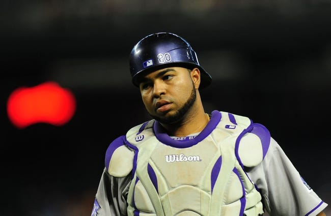 Jul 7, 2013; Phoenix, AZ, USA; Colorado Rockies catcher Wilin Rosario (20) reacts after a play in the second inning during a game against the Arizona Diamondbacks at Chase Field. Mandatory Credit: Jennifer Hilderbrand-USA TODAY Sports