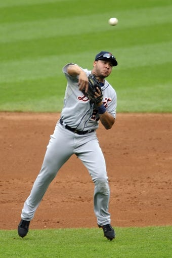 Jul 7, 2013; Cleveland, OH, USA; Detroit Tigers shortstop Jhonny Peralta (27) throws to first base on an infield hit by Cleveland Indians right fielder Drew Stubbs (not pictured) in the second inning at Progressive Field. Mandatory Credit: David Richard-USA TODAY Sports