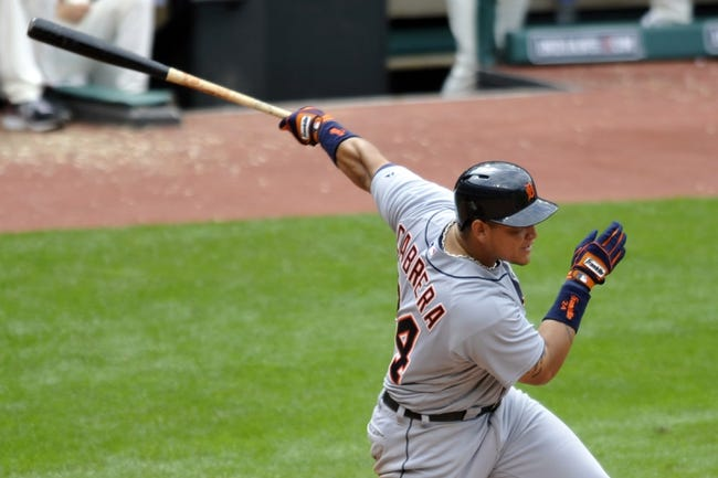 Jul 7, 2013; Cleveland, OH, USA; Detroit Tigers third baseman Miguel Cabrera (24) hits an RBI single in the seventh inning against the Cleveland Indians at Progressive Field. Mandatory Credit: David Richard-USA TODAY Sports