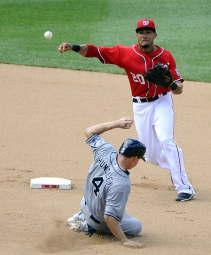 Jul 7, 2013; Washington, DC, USA; San Diego Padres catcher Nick Hundley (4) is forced out at second base by Washington Nationals shortstop Ian Desmond (20) during the seventh inning at Nationals Park. Mandatory Credit: Brad Mills-USA TODAY Sports