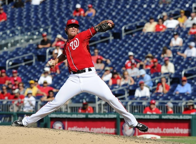 Jul 7, 2013; Washington, DC, USA; Washington Nationals relief pitcher Tyler Clippard (36) throws during the ninth inning against the San Diego Padres at Nationals Park. Mandatory Credit: Brad Mills-USA TODAY Sports
