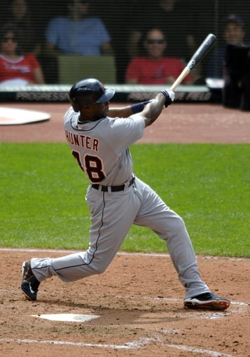 Jul 7, 2013; Cleveland, OH, USA; Detroit Tigers right fielder Torii Hunter (48) hits a three-run home run in the eighth inning against the Cleveland Indians at Progressive Field. Mandatory Credit: David Richard-USA TODAY Sports