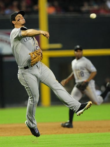 Jul 7, 2013; Phoenix, AZ, USA; Colorado Rockies third baseman Nolan Arenado (28) throws to first in the third inning during a game against the Arizona Diamondbacks at Chase Field. Mandatory Credit: Jennifer Hilderbrand-USA TODAY Sports