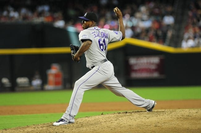Jul 7, 2013; Phoenix, AZ, USA; Colorado Rockies pitcher Edgmer Escalona (61) relieved Roy Oswalt (not pictured) in the second inning during a game against the Arizona Diamondbacks at Chase Field. Mandatory Credit: Jennifer Hilderbrand-USA TODAY Sports