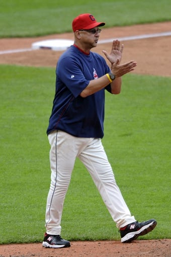 Jul 7, 2013; Cleveland, OH, USA; Cleveland Indians manager Terry Francona (17) makes a pitching change in the seventh inning against the Detroit Tigers at Progressive Field. Mandatory Credit: David Richard-USA TODAY Sports