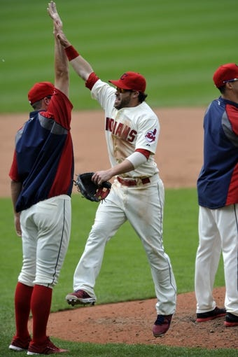 Jul 7, 2013; Cleveland, OH, USA; Cleveland Indians second baseman Jason Kipnis (right) celebrates a 9-6 win over the Detroit Tigers at Progressive Field. Mandatory Credit: David Richard-USA TODAY Sports