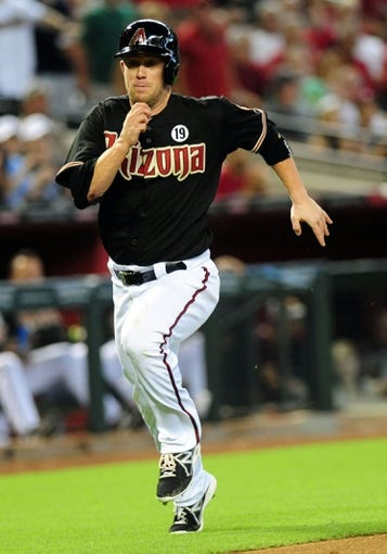 Jul 7, 2013; Phoenix, AZ, USA; Arizona Diamondbacks base runner Aaron Hill (2) runs for home plate in the fifth inning during a game against the Colorado Rockies at Chase Field. Mandatory Credit: Jennifer Hilderbrand-USA TODAY Sports