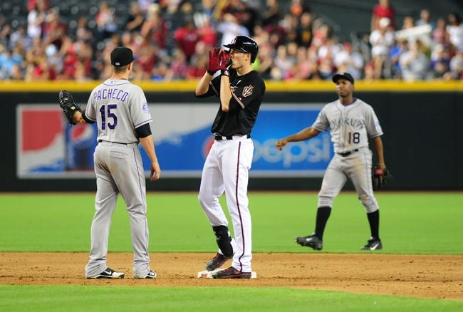 Jul 7, 2013; Phoenix, AZ, USA; Arizona Diamondbacks base runner Patrick Corbin (46) reacts after hitting a double in the sixth inning during a game against the Colorado Rockies at Chase Field. Mandatory Credit: Jennifer Hilderbrand-USA TODAY Sports