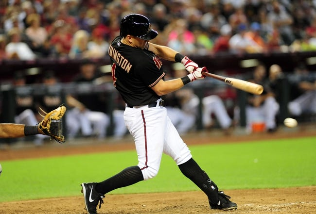 Jul 7, 2013; Phoenix, AZ, USA; Arizona Diamondbacks batter Cliff Pennington (4) singled to left in the sixth inning during a game against the Colorado Rockies at Chase Field. Mandatory Credit: Jennifer Hilderbrand-USA TODAY Sports