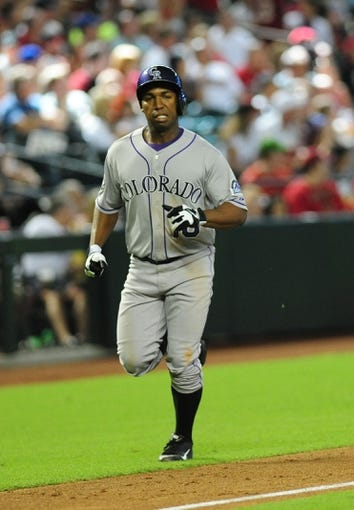 Jul 7, 2013; Phoenix, AZ, USA; Colorado Rockies base runner Jonathan Herrera (18) runs the bases after hitting a home run to left in the eighth inning during a game against the Arizona Diamondbacks at Chase Field. Mandatory Credit: Jennifer Hilderbrand-USA TODAY Sports