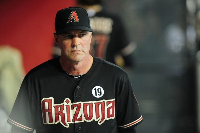 Jul 7, 2013; Phoenix, AZ, USA; Arizona Diamondbacks manager Kirk Gibson (23) stands inside the dugout in the eighth inning during a game against the Colorado Rockies at Chase Field. Mandatory Credit: Jennifer Hilderbrand-USA TODAY Sports