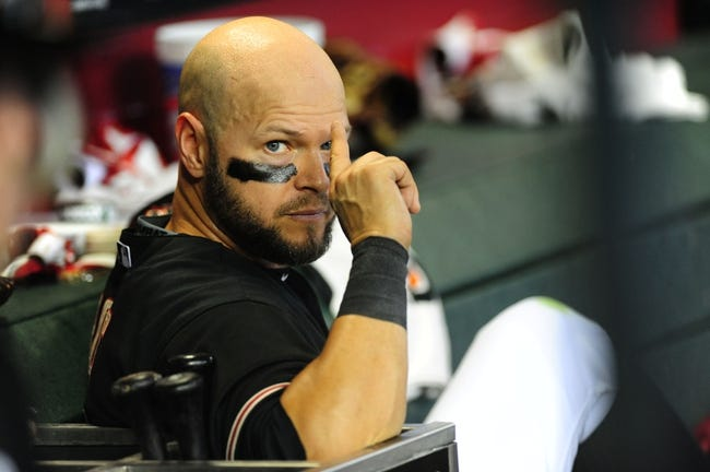 Jul 7, 2013; Phoenix, AZ, USA; Arizona Diamondbacks outfielder Cody Ross (7) sits inside the dugout during the ninth inning during a game against the Colorado Rockies at Chase Field. Mandatory Credit: Jennifer Hilderbrand-USA TODAY Sports