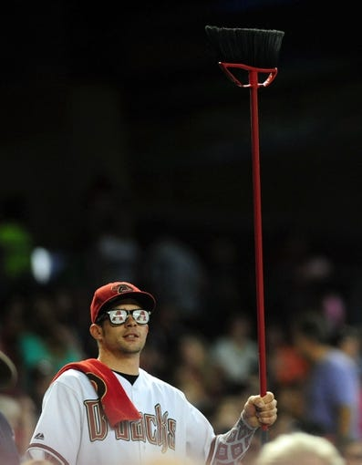 Jul 7, 2013; Phoenix, AZ, USA; Arizona Diamondbacks fan holds up a broom during the ninth inning during a game against the Colorado Rockies at Chase Field. Mandatory Credit: Jennifer Hilderbrand-USA TODAY Sports