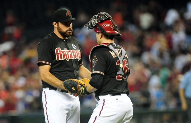Jul 7, 2013; Phoenix, AZ, USA; Arizona Diamondbacks pitcher Josh Collmenter (55) and catcher Miguel Montero (26) shake hands after a win against the Colorado Rockies at Chase Field. Diamondbacks won 6 to 1. Mandatory Credit: Jennifer Hilderbrand-USA TODAY Sports