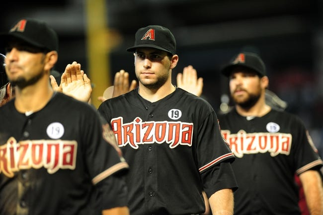 Jul 7, 2013; Phoenix, AZ, USA; Arizona Diamondbacks first baseman Paul Goldschmidt (44) high fives teammates after a win against the Colorado Rockies at Chase Field. The Arizona Diamondbacks won 6 to 1. Mandatory Credit: Jennifer Hilderbrand-USA TODAY Sports