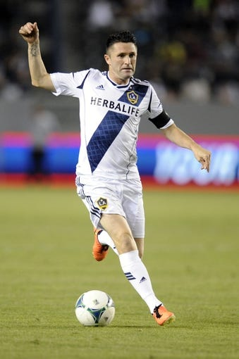 Jul 7, 2013; Carson, CA, USA; Los Angeles Galaxy forward Robbie Keane (7) runs the ball up the field against the FC Dallas during the second half at the StubHub Center. The Los Angeles Galaxy defeated the FC Dallas 2-0. Mandatory Credit: Kelvin Kuo-USA TODAY Sports