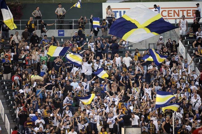 Jul 7, 2013; Carson, CA, USA; The Los Angeles Galaxy fans wave flags during the game between the Los Angeles Galaxy and FC Dallas during the first half at the StubHub Center. Mandatory Credit: Kelvin Kuo-USA TODAY Sports